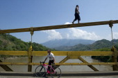 A man walks on a bridge before jumping into the Cauca river in Bolombolo municipality south of Medellin Antioquia department Colombia on February 25...