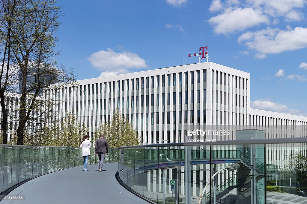 A man walks on a bridge which connects the buildings of the Deutsche Telekom headquarters on May 04, 2016 in Bonn, Germany.