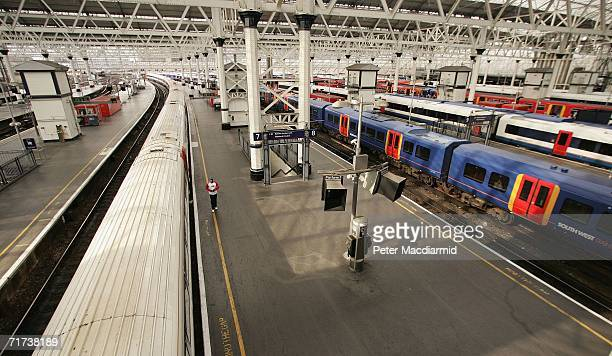 A man walks on a deserted platform at Waterloo railway station on August 29 2006 in London England South West Trains say that only 10% of their...