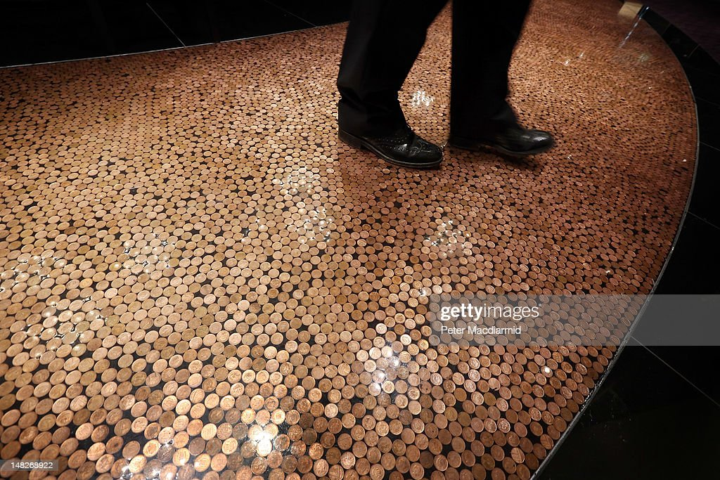A man walks on a floor inlaid with pennies at The Hippodrome Casino near Leicester Square on July 13, 2012 in London, England. The new casino has five floors and 90,000 square feet of slot machines, blackjack and roulette tables.
