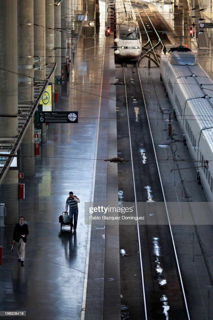 A man walks on a high speed train's platform while a train arrives in Atocha Train Station train on November 13, 2012 in Madrid, Spain. Spain's trade unions have called a general strike for November 14, the second general strike during Mariano Rajoy's presidency. Protestors from social movements are expected to join striking public sector workers to protest against austerity cuts and labour reforms. Spain's unemployment rate has now reached 25 per cent.