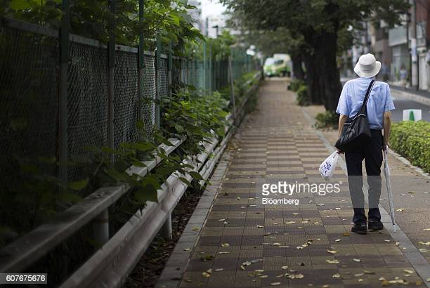 A man walks on a road in the Sugamo district of Tokyo Japan on Monday Sept 15 2016 The proportion of Japans aged has been rising steadily for decades...