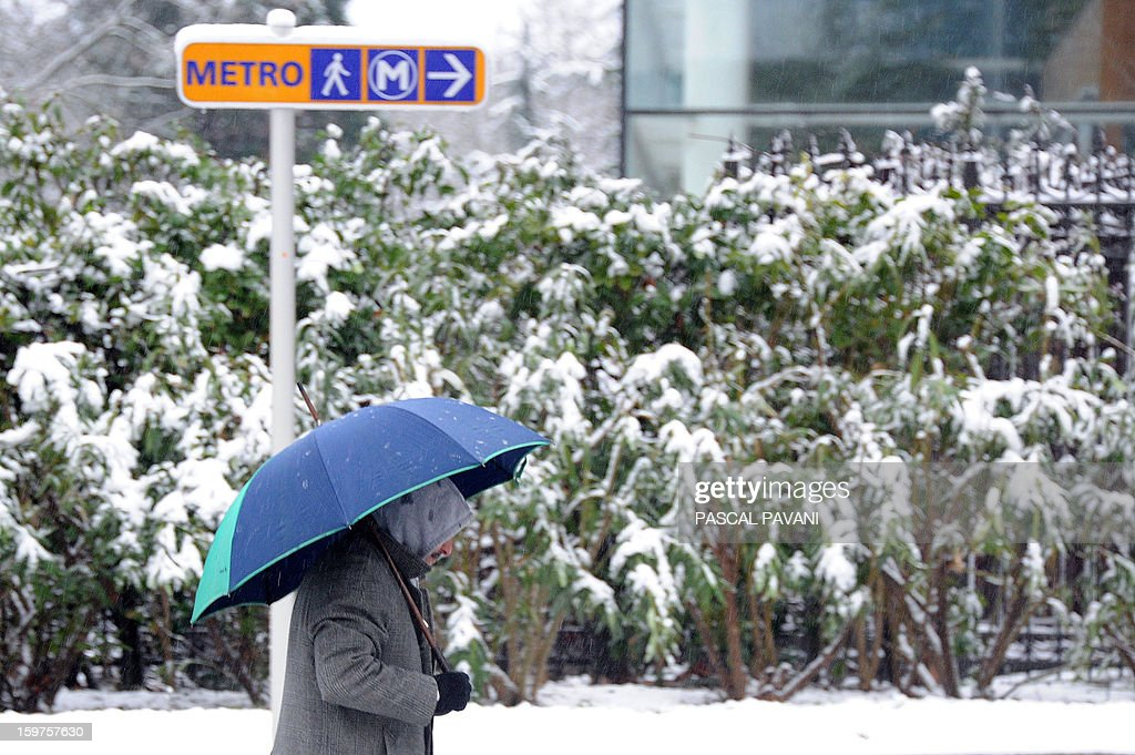 A man walks on a snow covered square on January 20, 2013 in Toulouse southern France, after heavy snow falls.