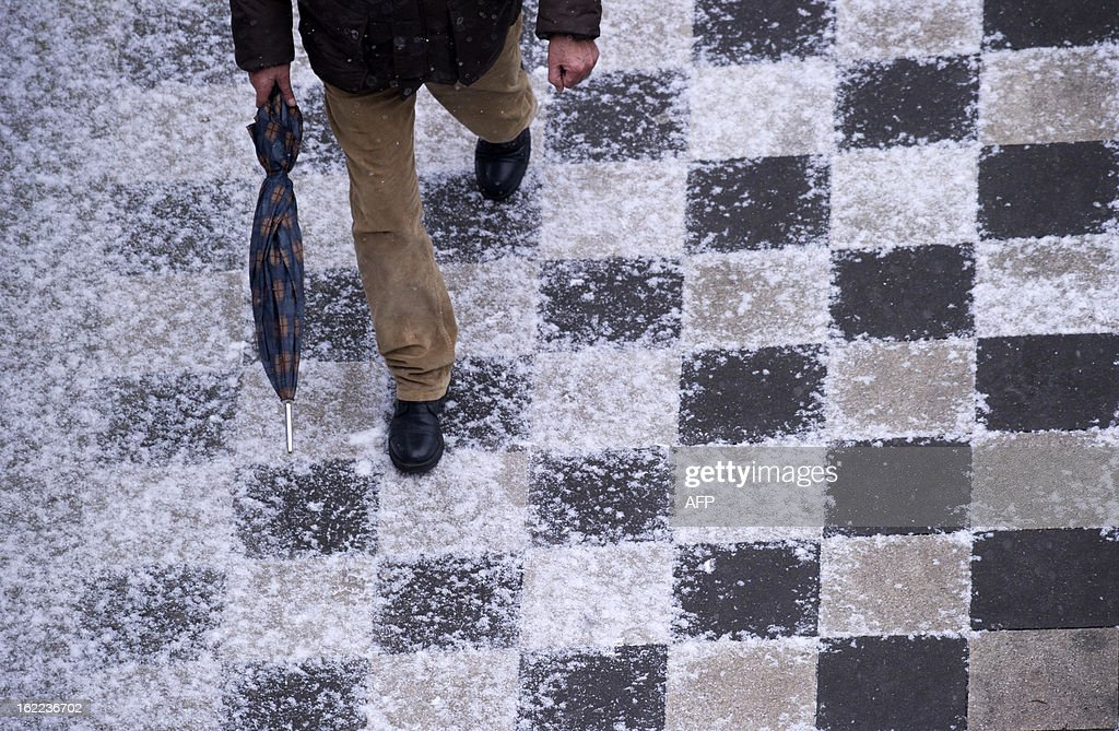 A man walks on a snow-covered pavement on February 21, 2013 in Duesseldorf.