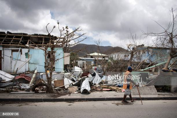 A man walks on a street on September 10 2017 in Marigot on the island of SaintMartin after it was devastated by Irma hurricane / AFP PHOTO / Martin...