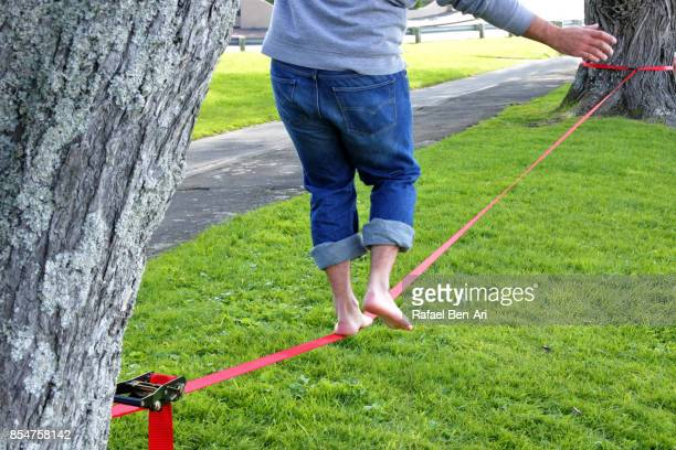 Man walks on a tightrope
