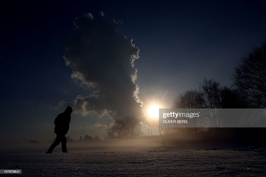 A man walks on December 8, 2012 near the RWE lignite power plant in Bergheim, western Germany.