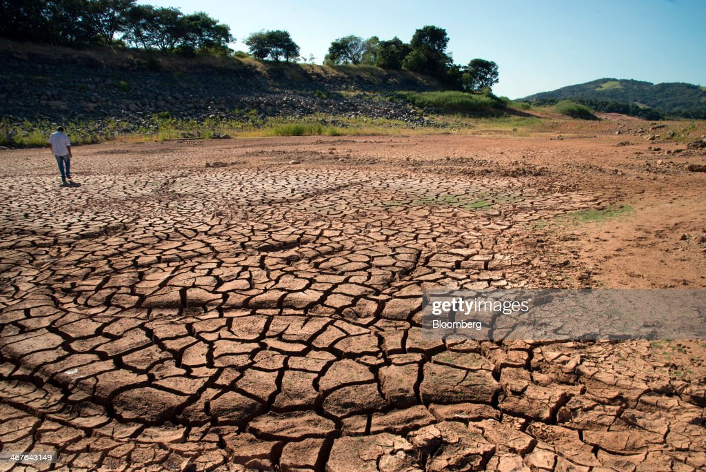 http://media.gettyimages.com/photos/man-walks-on-dry-cracked-earth-where-water-usually-stands-at-the-picture-id467643149
