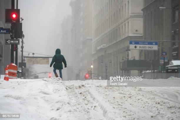 A man walks on Snowy Street during the snowstorm at Midtown Manhattan on Mar. 14 2017.