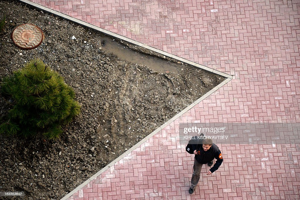 A man walks on the embankment in the Rosa Khutor Mountain Resort close to Russian Black Sea resort of Sochi on March 8, 2013. The temperature in Sochi reached 12C, but due to high sunlight, weather experts said it would feel like 18C.