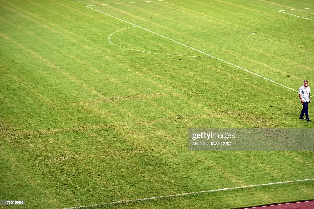 A man walks on the pitch appearing to show the pattern of a swastika following the the Euro 2016 qualifying football match between Croatia and Italy...