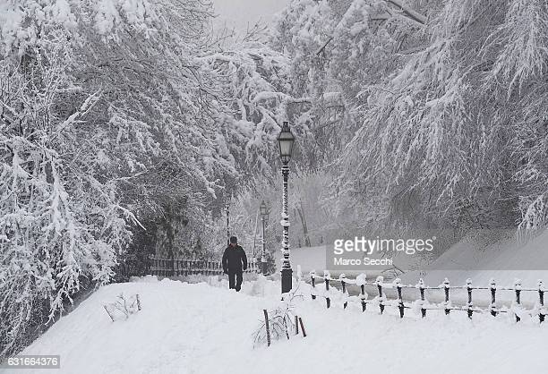 A man walks on the road leading to the Castle on January 1 2017 in Ljubljana Slovenia Most of Slovenia was covered by heavy snowfalls for the first...