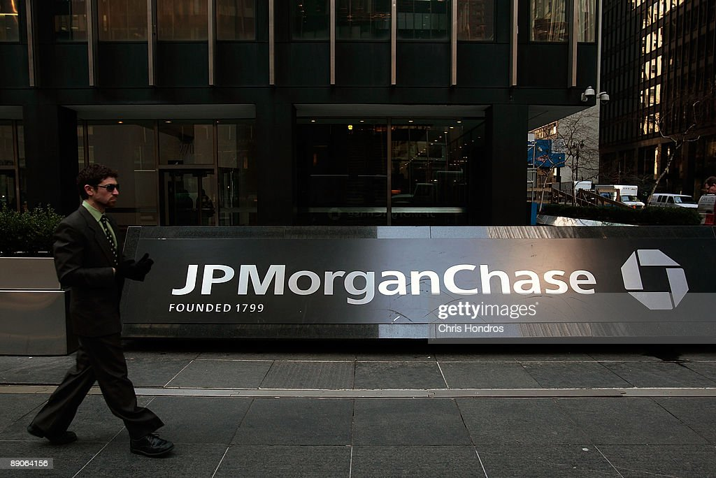 A man walks on the sidewalk in front of the JP Morgan Chase building March 24, 2008 in New York City. The banking giant posted a $2.7 billion profit in the second quarterJuly 16, 2009, a 36% jump from 2008. Revenues were up 39%, at $25.62 billion.