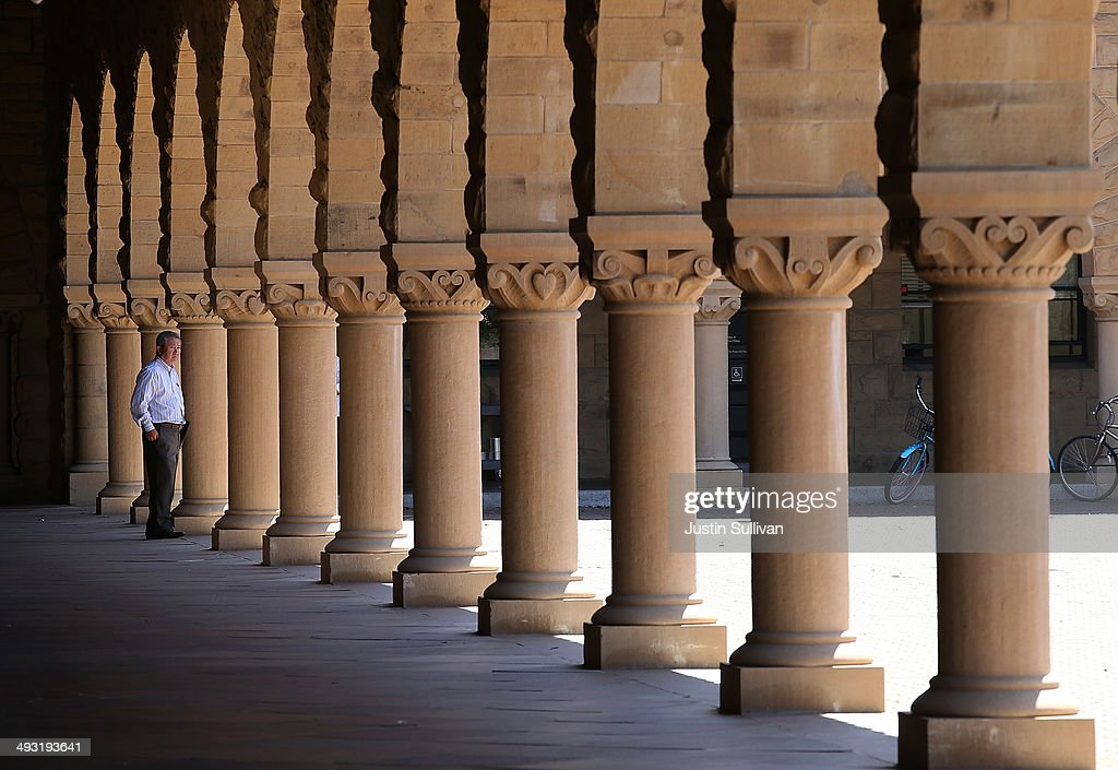 A man walks on the Stanford University campus on May 22 2014 in Stanford California According to the Academic Ranking of World Universities by...