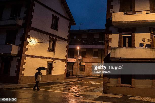 A man walks on the street on November 24 2016 in Sobre Las Vegas Spain The struggling coal mining industry is on its way out in Spain The European...