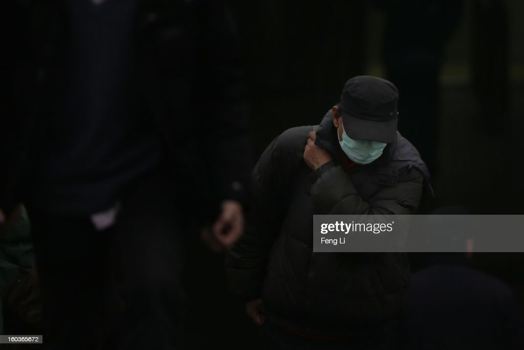 A man walks out a subway station during severe pollution on January 30, 2013 in Beijing, China. The fourth round of heavy smog to hit Beijing in one month has sent more people to the hospital with respiratory illnesses and prompted calls for legislation to curb pollution. The haze choking many Chinese cities covers a total area of 1.3 million square kilometers, the China's Ministry of Environmental Protection said Tuesday.