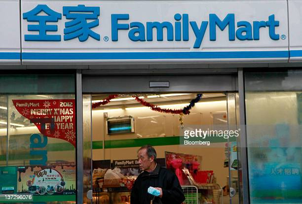 A man walks out of a FamilyMart Co convenience store in Shanghai China on Sunday Jan 15 2012 FamilyMart Co Japan's largest convenience store operator...