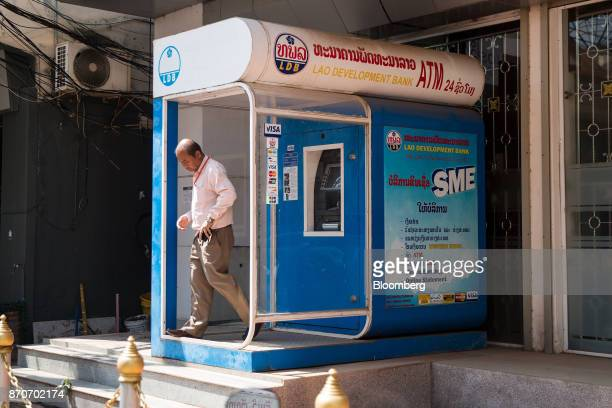 A man walks out of a Lao Development Bank automated teller machine booth in Vientiane Laos on Thursday Nov 2 2017 Located in the Mekong region...