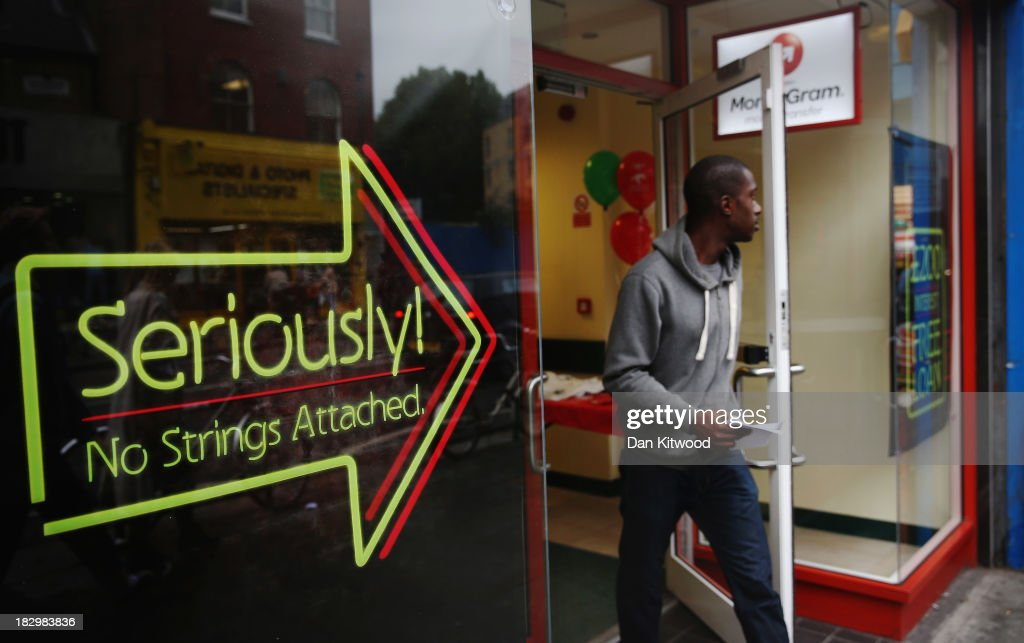 A man walks out of a payday loan store in Dalston on October 3 2013 in London England Payday loan stores are to face tougher regulations after moves...