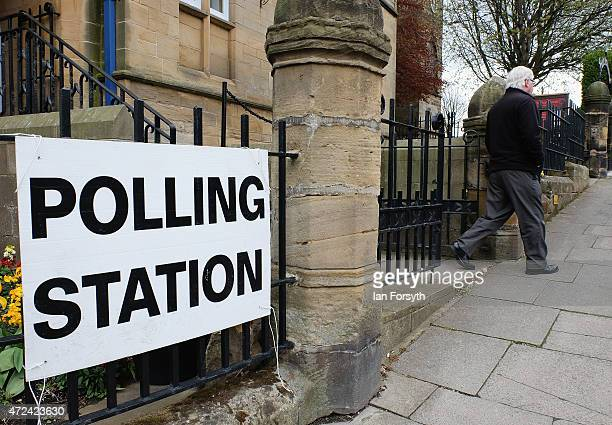 A man walks out of a polling station in St Leonards Church on May 7 2015 in Loftus England The United Kingdom has gone to the polls to vote for a new...