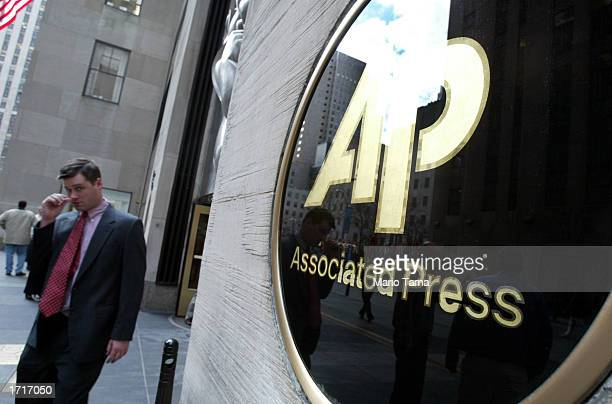 A man walks out of Associated Press headquarters January 9 2003 in New York City Because of a contract dispute about 1700 reporters photographers and...