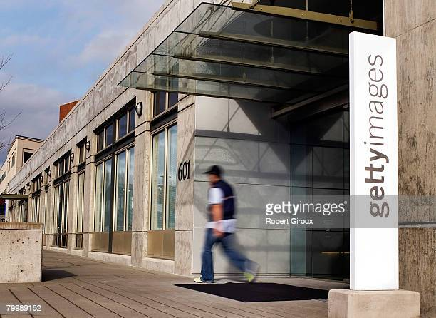 A man walks out of Getty Images corporate headquarters February 25 2008 in Seattle Washington The company announced it had been acquired by private...