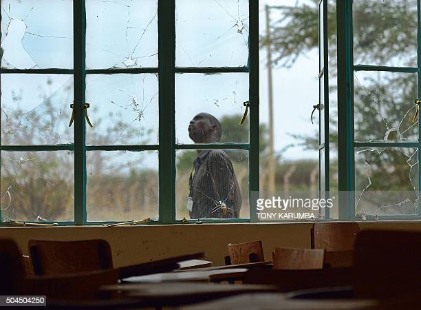 A man walks outside a lecture hall with bulletshattered window panes in Garissa university on January 11 2016 Students trickled back on January 11...