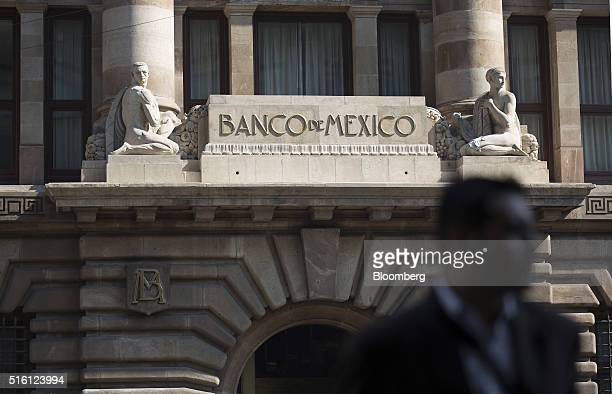 A man walks outside Mexico's central bank headquarters the Banco de Mexico in Mexico City Mexico on Tuesday March 15 2016 Mexico is scheduled to...