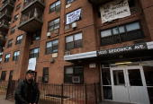 A man walks outside of 1520 Sedgwick Avenue a building considered by many to be the birthplace of the popular 'hip hop' style of music January 15...
