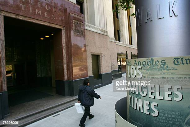 A man walks outside the Los Angeles Times building April 23 2007 in Los Angeles California The Times announced today that it will offer voluntary...