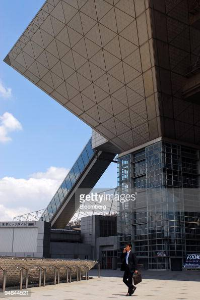 A man walks outside the Tokyo International Exhibition Center also known as Tokyo Big Site in Tokyo Japan on Sunday June 3 2007 The exterior of the...