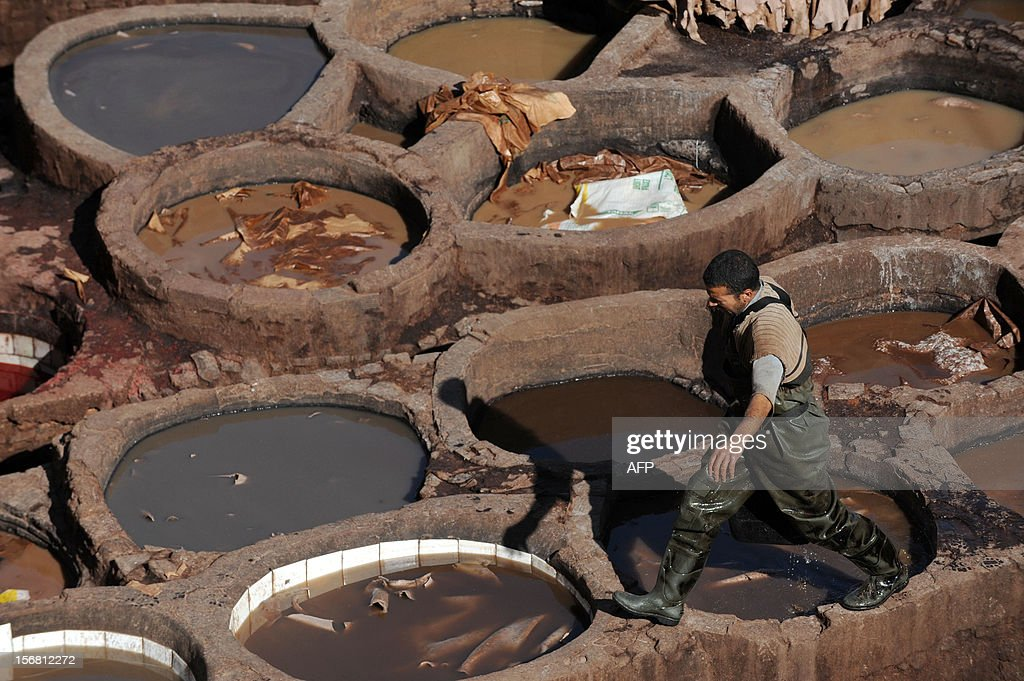 A man walks over dying pools at the tanneries in Fes on November 21, 2012. AFP / PHOTO / FADEL