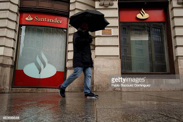 A man walks pass a Banco Santander's office on February 2 2015 in Madrid Spain The eurozone's largest bank announced profits rose in all its 10 key...