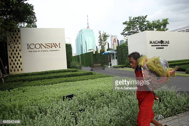 A man walks passed the entrance to the construction site of ' Icon Siam ' the biggest community mall project in Thailand The THB 50billion Chao...