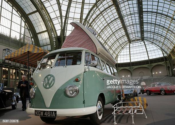 A man walks past a 1963 Volkswagen Type Flipseat camping car on display on February 3 2016 during a sale of vintage cars and motorcycles at the Grand...