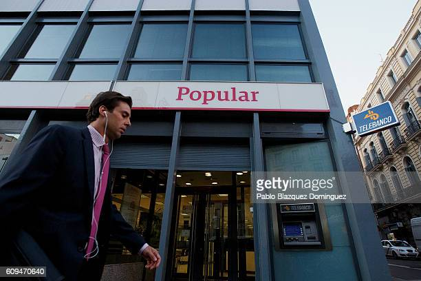 A man walks past a Banco Popular branch on September 21 2016 in Madrid Spain Spain's Banco Popular plans to cut around 3000 jobs and close 300...
