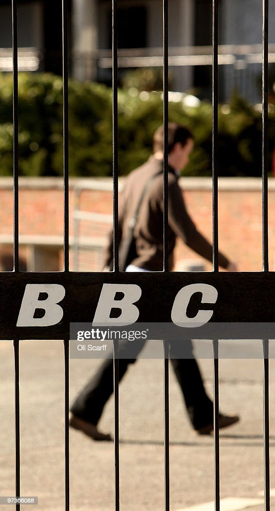 A man walks past a BBC logo on the gates of Television Centre on March 2, 2010 in London, England. The corporation have today published their strategy review which proposes the closure of the digital radio stations 'BBC 6 Music' and 'Asian Network' and half of the websites provided by BBC online will close by 2013. A public consultation will now take place before the BBC Trust make a decision on which proposals to implement.