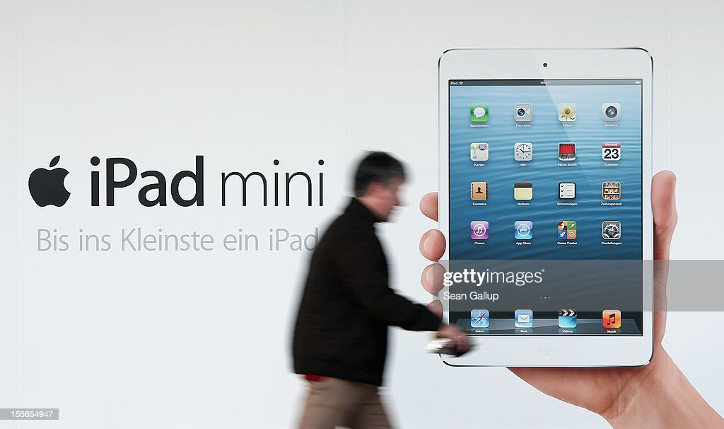 A man walks past a billboard advertising the new Apple iPad mini on November 6, 2012 in Berlin, Germany. Apple recently released the Mini to compete with the growing number of small, tablet computers and the company is hoping for a strong Christmas season.