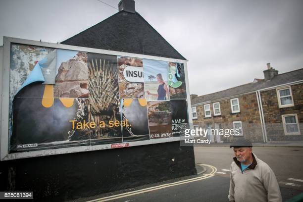 A man walks past a billboard in Camborne on July 24 2017 in Cornwall England Figures released by Eurostat in 2014 named the British county of...
