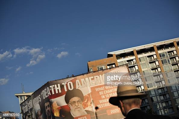 A man walks past a billboard lobbying against an agreement with Iran over its nuclear program September 17 2015 in Washington DC Iran's foreign...