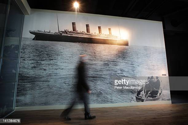 A man walks past a blow up of the last ever photograph taken of The Titanic as she departs Queenstown on April 11 1912 at the Titanic Belfast...