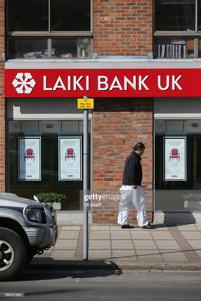 A man walks past a branch of Laiki Bank UK, a subsiduary of Cyprus Popular Bank, on April 2, 2013 in London, England. Customers with funds in Laiki Bank UK will not face a levy on their accounts, which is being imposed in Cyprus on deposits of over 100,000 Euros as part of the European Union's bail-out package for the Cypriot economy. The Bank of England's Prudential Regulation Authority has announced that all deposits in Laiki Bank UK will be automatically transferred to Bank of Cyprus in the UK.
