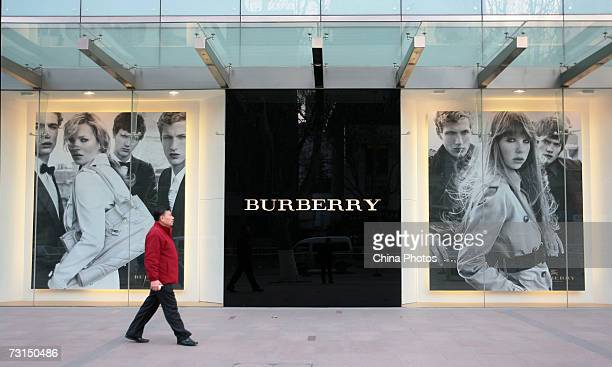 A man walks past a Burberry store on January 30 2007 in Nanjing of Jiangsu Province China British luxury goods retailer Burberry has recently...