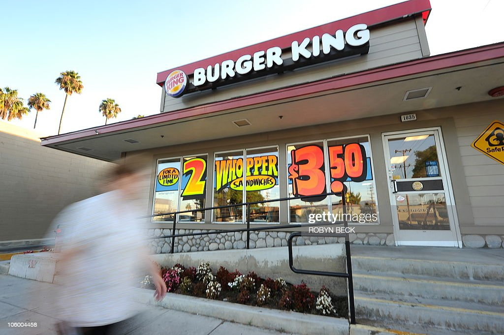 A man walks past a Burger King restaurant in Glendale California on September 2 2010 Burger King the secondlargest US hamburger chain will be sold to...