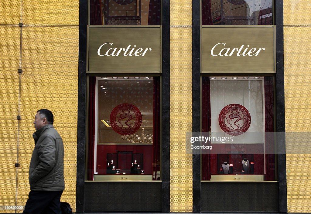 A man walks past a Cartier store, operated by Cie. Financiere Richemont SA, in Shanghai, China, on Wednesday, Feb. 6, 2013. China's economic growth accelerated for the first time in two years as government efforts to revive demand drove a rebound in industrial output, retail sales and the housing market. Photographer: Tomohiro Ohsumi/Bloomberg via Getty Images