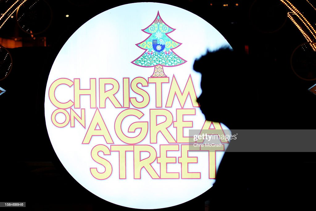 A man walks past a Christmas light setup on Orchard road on December 17, 2012 in Singapore.