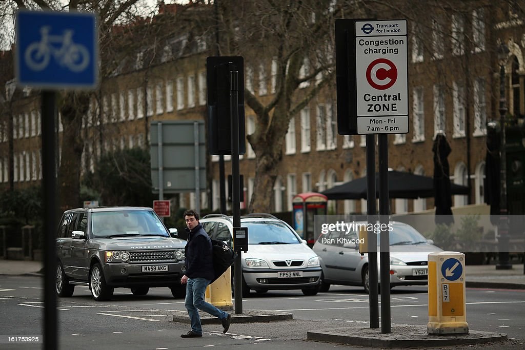 A man walks past a congestion charge sign in Kennington on February 15, 2013 in London, England. The weekday charge was introduced by the then Mayor of London Ken Livingstone on February 17, 2003 and celebrates its tenth anniversary on Sunday. Originally costing 5 GBP it has risen over the years to its current price of 10 GBP.