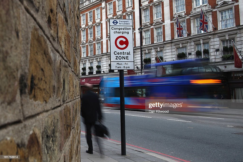 A man walks past a congestion charge sign in Victoria on February 15, 2013 in London, England. The weekday charge was introduced by the then Mayor of London Ken Livingstone on February 17, 2003 and celebrates its tenth anniversary on Sunday. Originally costing 5 GBP it has risen over the years to its current price of 10 GBP.