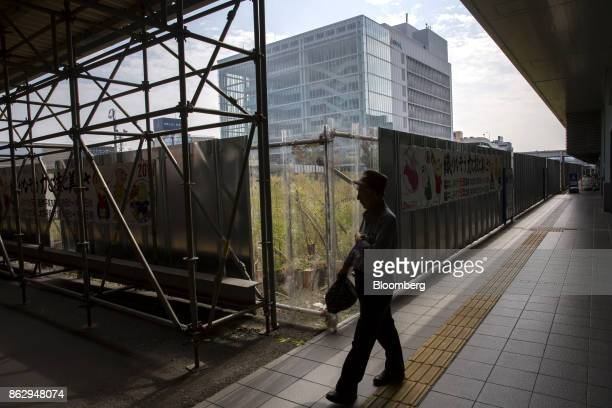 A man walks past a construction site near Fukui station in Fukui Japan on Tuesday Oct 10 2017 Fukui Prefecture has one of the lowest rates of...