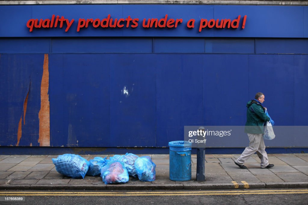 A man walks past a discount retailer '99p Store' on Lewisham high street on December 5, 2012 in London, England. The Chancellor of the Exchequer George Osborne has stated that the United Kingdom's economy is still struggling during his autumn budget statement to Parliament.